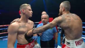 Boxer Andrei Mikhailovich Gets Punched In The Stomach By His Rival Before The Bell