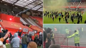 Manchester United Fans Flood Onto Old Trafford Pitch During Protest