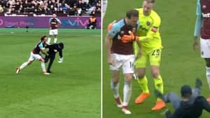 West Ham Fan Enters The Pitch, Mark Noble Throws Him To The Floor