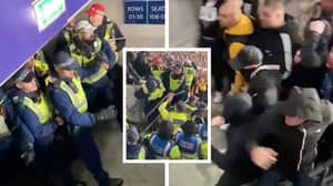 Shocking Video Shows Outnumbered Police In Scary Stand-Off With Hungarian Football Fans