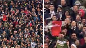 A Juventus Fan Spotted Trolling 80,000 Tottenham Supporters By Pointing At Arsenal Shirt