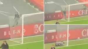 Protesting Manchester United Fan Sent Flying Off Goal Net At Old Trafford By Stray Football
