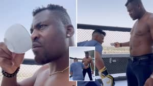 Francis Ngannou Sips Coffee While Man Tries To Hit Him As Hard As Possible In Body Shot Challenge