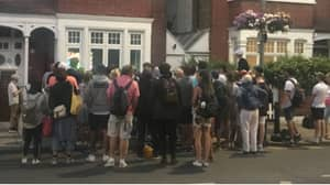 Fans Gather Outside House With Big Telly To Watch England Match