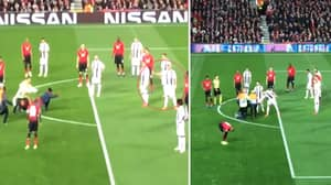 Old Trafford Pitch Invader Crawls Over To Cristiano Ronaldo After Being Taken Out By Stewards