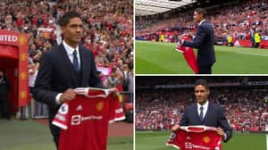 Raphael Varane Walks Out To Incredible Reception At Old Trafford After Being Unveiled Before Kick-Off vs Leeds