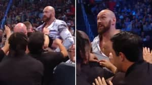 Tyson Fury Jumps The Barrier And Held Back By Security At WWE Smackdown