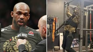 Jon Jones Trains With Machine Gun In Full Camo Gear As Heavyweight Preparation Continues