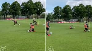 Ajax's 'Slide Tackle Pass' Training Drill Is All Kinds Of Mental