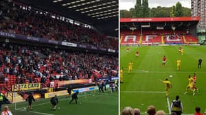 Charlton Fans Throw Packets Of Crisps On The Pitch In Protest