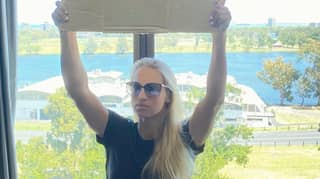 Quarantined Tennis Player Yulia Putintseva Holds Up Sign Saying 'We Need Fresh Air To Breathe'
