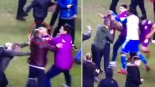Watch: Sergio Aguero Hits Wigan Fan During Post-Match Pitch Invasion