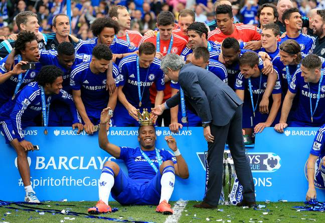 Jose Mourinho places the Premier League crown on the king's head. Image: PA Images