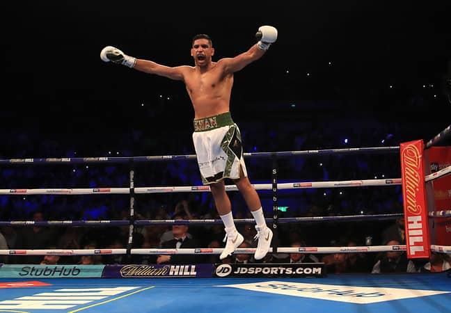 Khan celebrates beating Lo Greco. Image: PA
