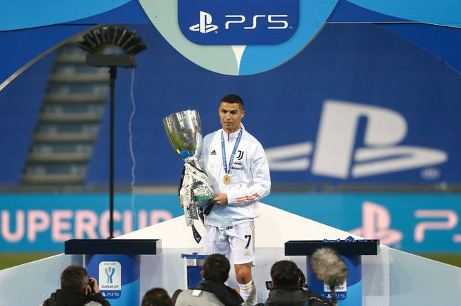 Ronaldo with his latest trophy. Image: PA Images