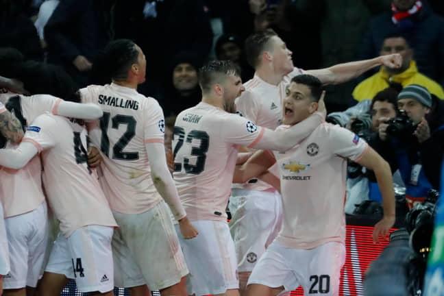 United celebrating victory over PSG (Image Credit: PA)