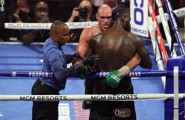 Tyson Fury pretends to lick Deontay Wilder's blood during their second bout. Credit: PA