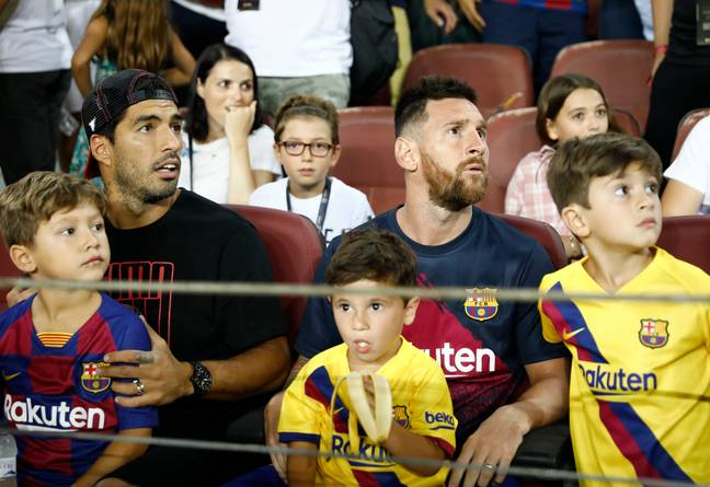 Messi sits in the stand with fellow injured Barca star Luis Suarez. Image: PA Images
