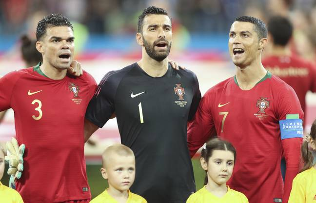 Ronaldo belts out the Portuguese national anthem. Image: PA