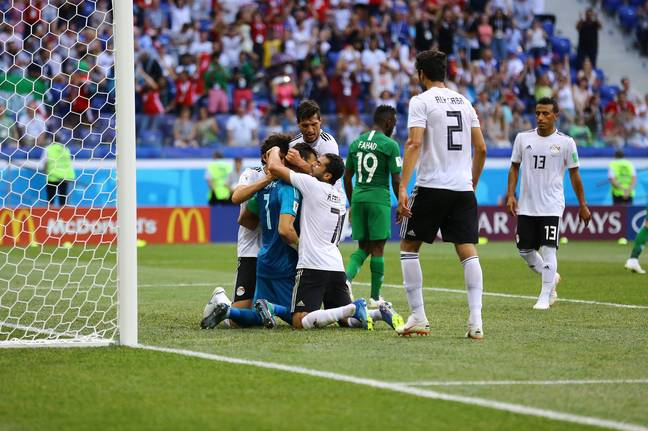El-Hadary is engulfed by Egypt players after his penalty save. Image: PA Images