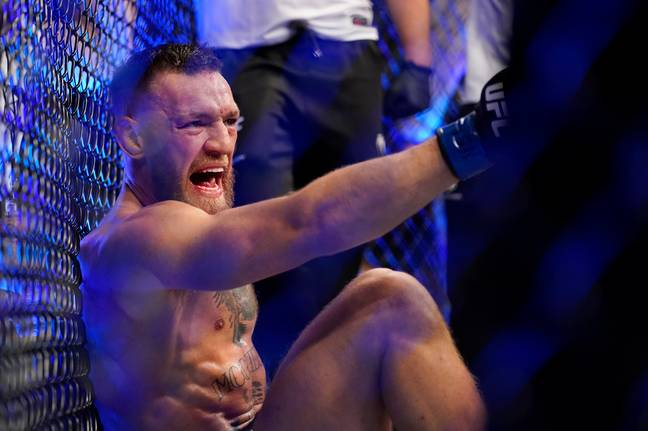 McGregor was still involved in trash talk as he sat in agony on the ground. Image: PA Images