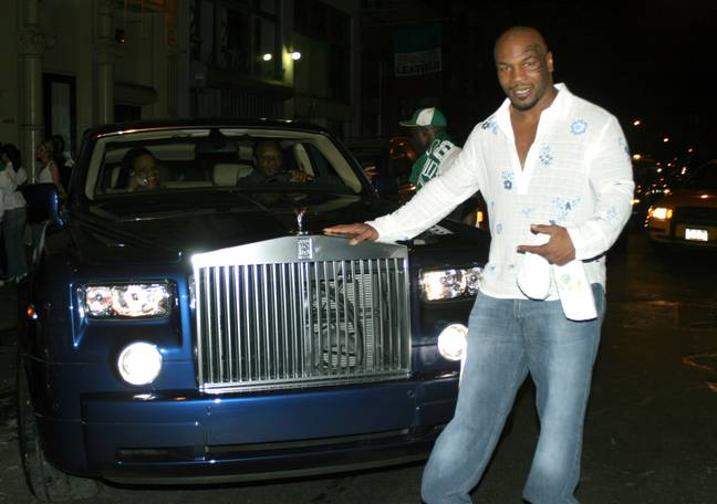 Mike Tyson poses with one of his Rolls-Royce cars. Credit: Instagram
