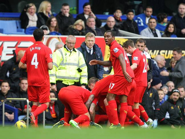 Luis Suarez takes a dive at David Moyes after scoring in the Merseyside derby