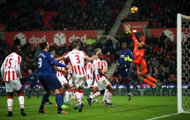 Rooney curls in his record breaking goal. Image: PA Images