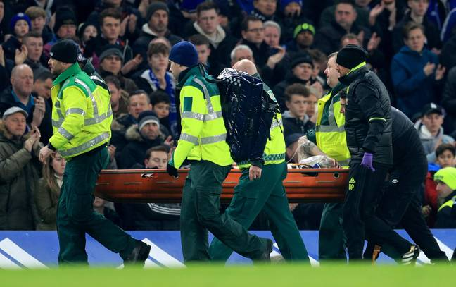 Mason stretchered off after the collision with Cahill. Image: PA Images.