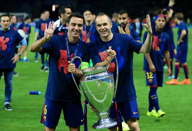 Xavi with midfield partner Andres Iniesta. Image: PA Images