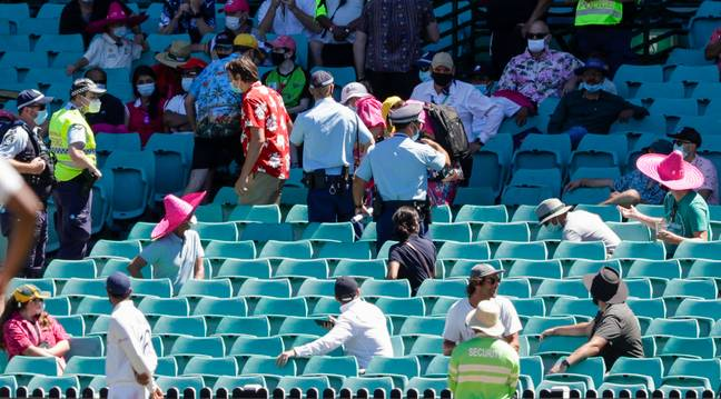 Police escorted fans out of the SCG. Credit: PA