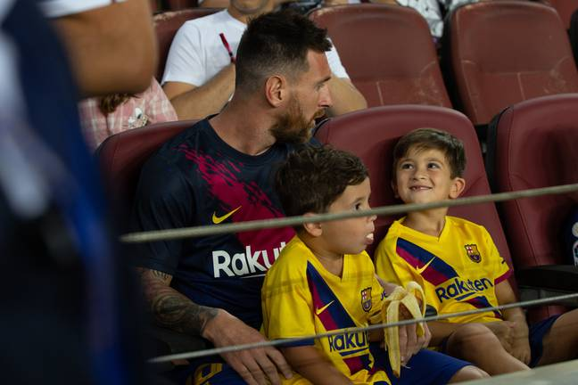 Messi sat in the stands with his kids instead of playing. Image: PA Images