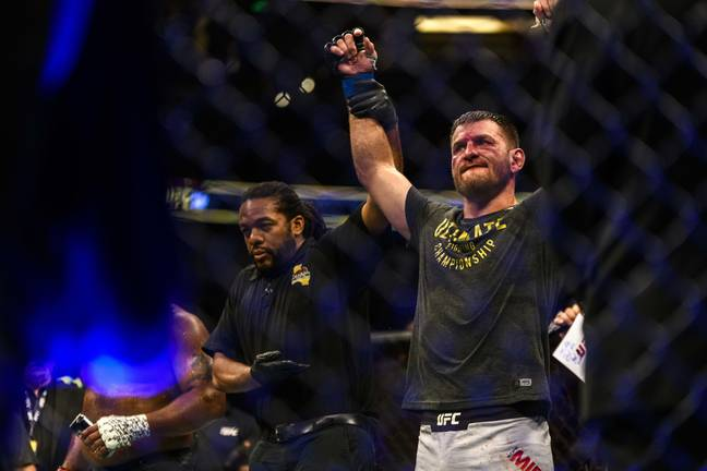 Miocic has his arm raised after winning the rematch. Image: PA Images