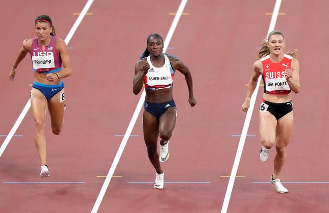 Dina Asher-Smith competing in the Women's 100m at Tokyo. (Credit: PA)