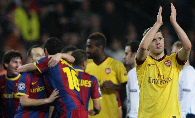 Wilshere applauds the away fans as Barcelona celebrate going through in the second leg. Image: PA Images
