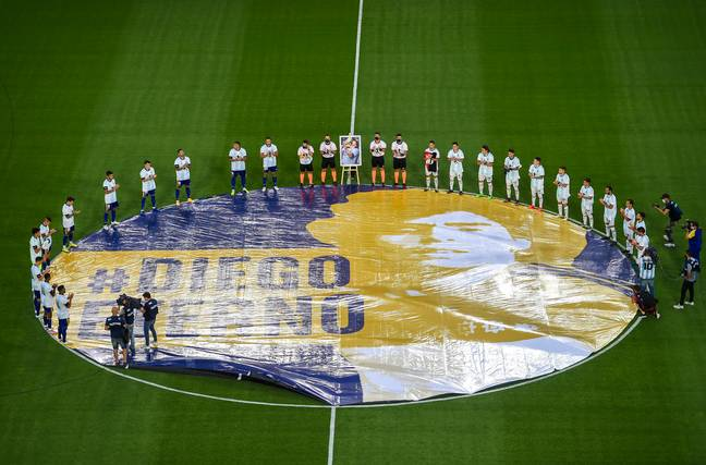 The players pay tribute to Maradona ahead of kick off. Image: PA Images