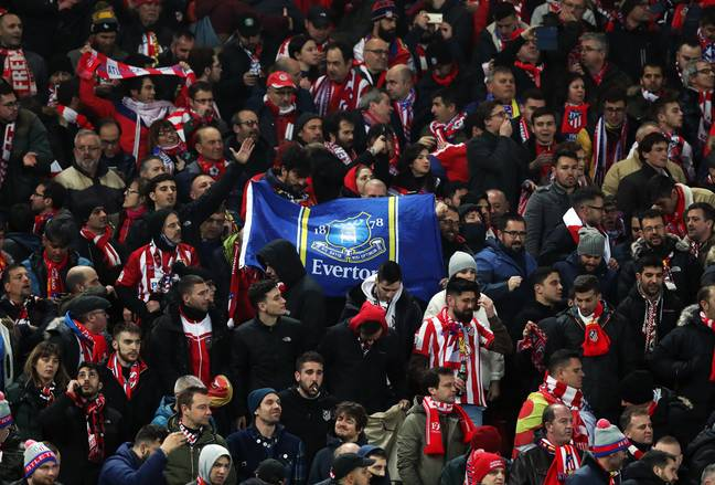 Atletico Madrid fans, holding up an Everton flag, were allowed to travel to Liverpool despite Madrid being one of the worst hit areas. Image: PA Images