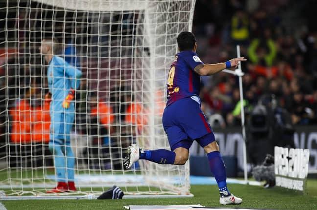 Suarez wheels away in celebration. Image: PA