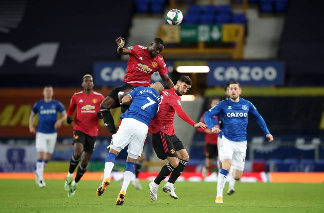 Bailly jumps into Richarlison following the nudge from Fernandes. Image: PA Images