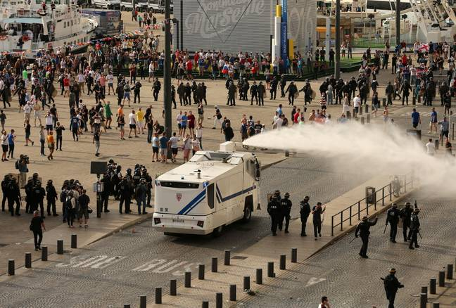 Police use water cannons to split Russian and English fans at the Euros. Image: PA Images
