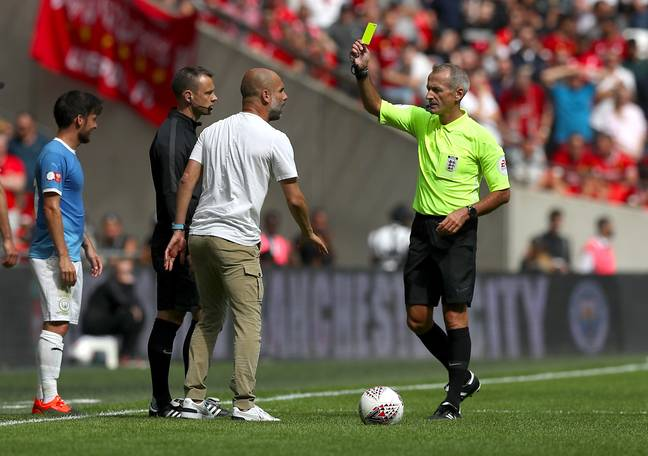 Guardiola picked up his first yellow of the season, kind of. Image: PA Images