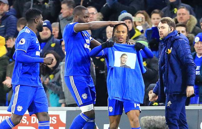 Reid celebrates one of his goals by holding up a shirt with Sala's face on. Image: PA Images