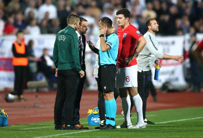 The referee talks to Gareth Southgate after stopping the game. Image: PA Images