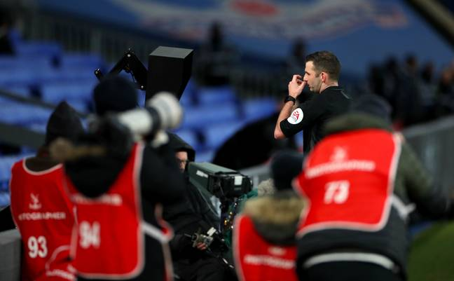 Michael Oliver checks the screen. Image: PA Images