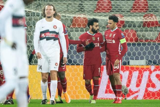 Salah celebrates with captain Trent. Image: PA Images