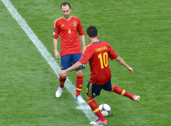 Fabregas and Iniesta playing together for Spain. Image: PA Images