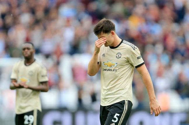 Harry Maguire trying not to watch United's performance, fans will relate. Image: PA Images