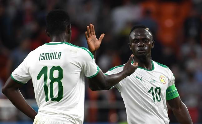 Senegal's Sadio Mane claps with teammate Ismaila Sarr after the 2018 FIFA World Cup Group H match between Japan and Senegal. Image: PA