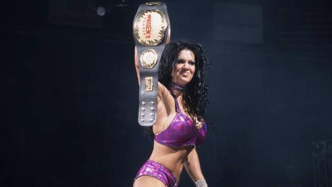 With the Women's title belt. Image: WWE