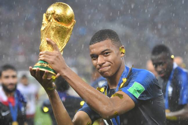 Mbappe with World Cup trophy. Credit: PA